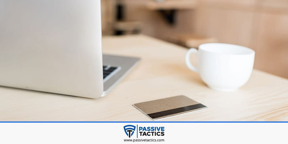 A laptop, a cup of coffee and a credit card to purchase a Bluehost plan.