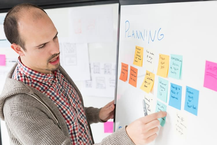 This marketer is using colorful stickers for planning for his business