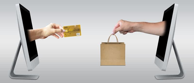 A purchase made via two computer screens and a credit card.